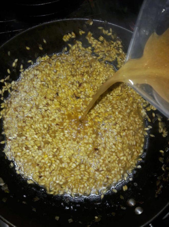 Add a few spoonfuls of broth every few minutes