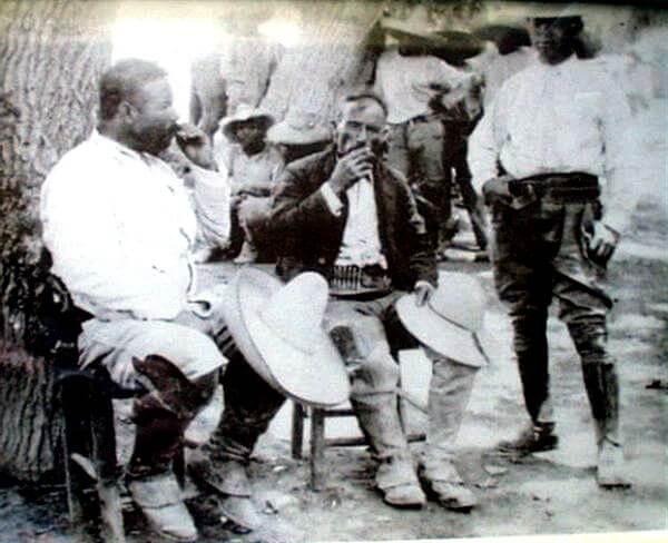"On the left, Jose Doroteo Arango Arámbula, ""Pancho Villa"", enjoying a marijuana cigarette"